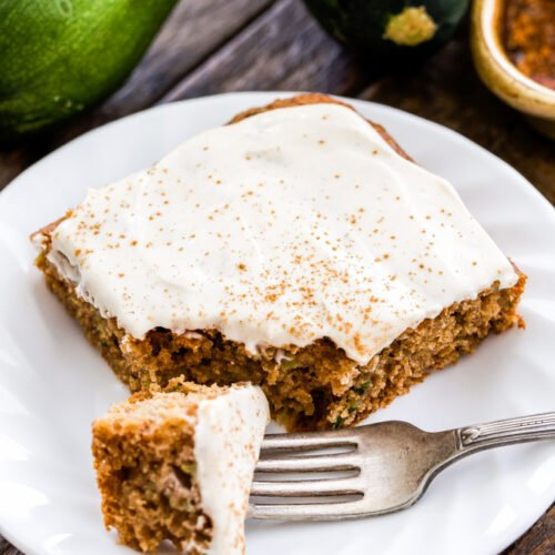 This easy to make Zucchini Spice Sheet Cake with cinnamon cream cheese frosting is perfect for making anytime of year. Whole wheat, sweetened with honey, loaded with warm spices and super moist! No one will suspect that it's been made with healthier ingredients!