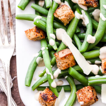 Everything you love about Caesar salad with a delicious twist. Green beans instead of lettuce! This Green Bean Caesar Salad is the perfect alternative to the traditional version and a great side dish to add to your table this holiday season!