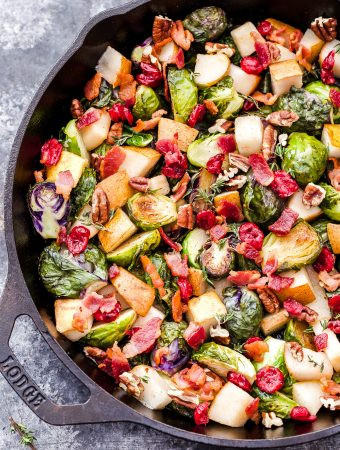 Roasted Brussels Sprouts with Pears, Bacon and Cranberries will be your new favorite holiday side dish! Tons of savory, sweet flavor and it's all made in one skillet! (Gluten-free and Paleo) #brusselssprouts #pears #cranberries #sidedish #thanksgiving #christmas #fallrecipe #glutenfree #paleo #skillet