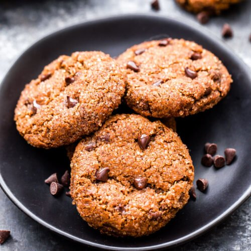 Gingerbread Chocolate Chip Almond Butter Cookies on a black plate.