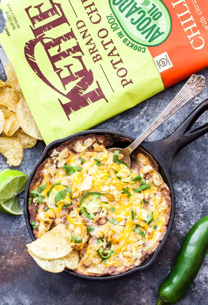 Cheesy Baked Jalapeño Black Bean Dip is the ultimate dip to serve for the big game or your next party! Cheesy, creamy and a little spicy, it will be gone before the game even starts! #appetizer #beandip #superbowl #glutenfree #vegetarian #easyrecipe #blackbeans #jalapeno