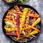 Fragrant, sweet, warmly spiced Garam Masala and Honey Roasted Carrots are the perfect side dish to serve with dinner. Topped with chopped pistachios and fresh mint, they're sure to be your new favorite way to eat carrots! #carrots #garammasala #sidedish #glutenfree #healthyrecipe #paleo #honey