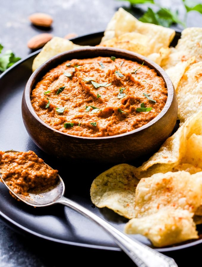 This quick and easy Smoked Romesco Dip is perfect for game day or your next party! Almonds, roasted red peppers, garlic and plenty of smoked paprika make it a flavorful and highly addicting dip! #dip #appetizer #superbowl #romesco #roastedredpeppers #almonds #glutenfree #vegetarian