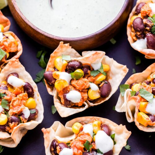 Barbecue Salmon, Black Bean and Corn Taco Cups are an easy, healthy and fun twist on taco night! Barbecue and Southwest flavors are combined together in these tasty 2-bite tacos! #salmon #tacos #blackbeans #appetizer #easyrecipe #easydinner #barbecue