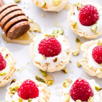 These Honey Goat Cheese and Raspberry Phyllo Cups are perfectly portioned and couldn't be easier to make! A delicious, no-fuss dessert that's perfect for Valentine's Day!#dessert #easyrecipe #goatcheese #raspberries #honey #healthydessert #appetizer