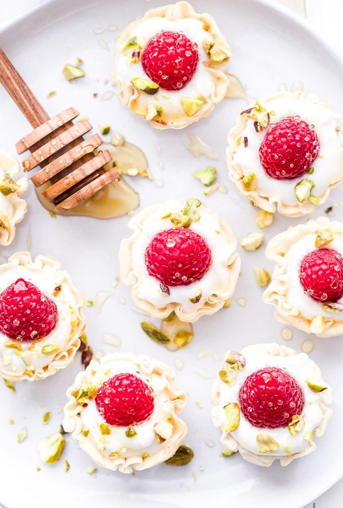 These Honey Goat Cheese and Raspberry Phyllo Cups are perfectly portioned and couldn't be easier to make! A delicious, no-fuss dessert that's perfect for Valentine's Day! #dessert #easyrecipe #goatcheese #raspberries #honey #healthydessert #appetizer