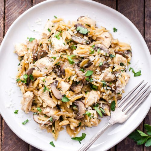 Parmesan Herb Chicken, Mushroom and Orzo Skillet is a one pan, easy to make, comfort food dinner the whole family will love! #chicken #onepot #pasta #dinner #easyrecipe
