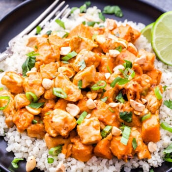 Skillet Thai Chicken and Sweet Potato Curry is a healthy, warming, comfort food meal that can be on the table in 30 minutes. Savory, sweet and a little bit spicy, this flavorful skillet dinner will be a family favorite!#thaifood #chicken #sweetpotato #curry #healthy #glutenfree
