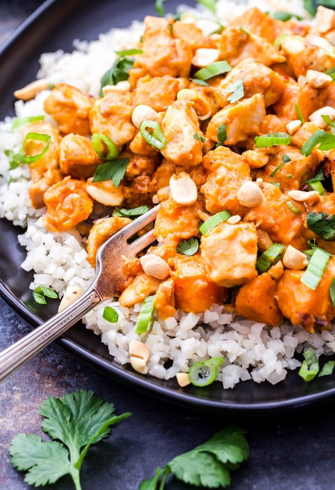 Skillet Thai Chicken and Sweet Potato Curry is a healthy, warming, comfort food meal that can be on the table in 30 minutes. Savory, sweet and a little bit spicy, this flavorful skillet dinner will be a family favorite! #thaifood #chicken #sweetpotato #curry #healthy #glutenfree