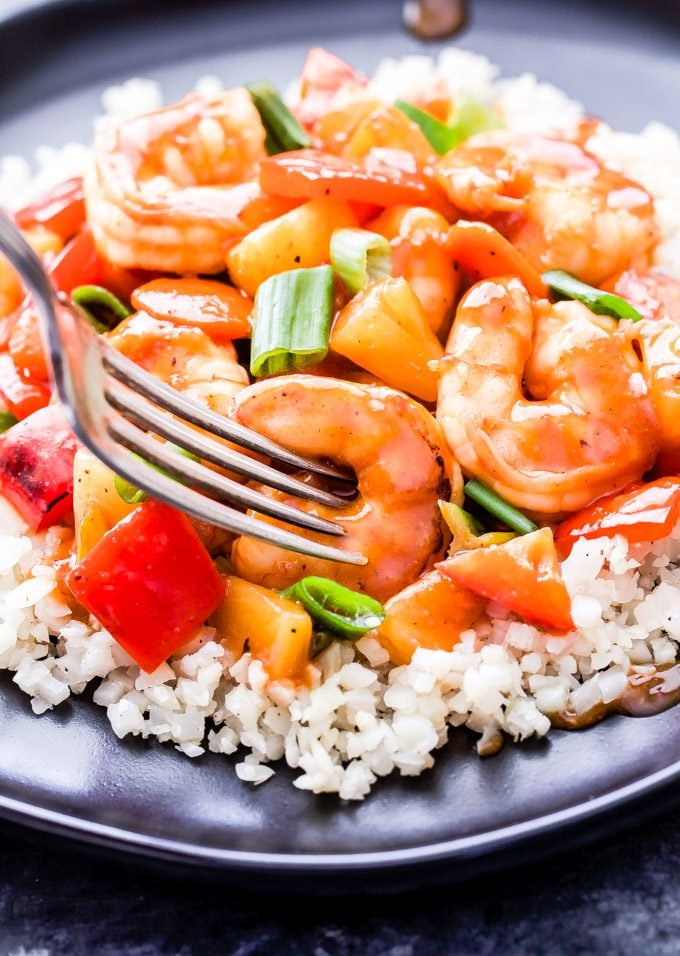 This healthier Sweet and Sour Shrimp Stir-Fry has all the flavor of your favorite restaurant version without all the calories and loads of sugar! Gluten-free and on the table in 30 minutes or less! #stirfry #sweetandsour #shrimp #healthy #glutenfree