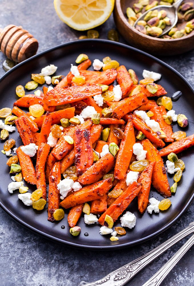 Moroccan Roasted Carrots with Goat Cheese, Pistachios and Golden Raisins. A sweet, earthy, slightly spicy side dish that's loaded with texture and flavor! #carrots #moroccan #vegetarian #sidedish #glutenfree #healthyrecipe