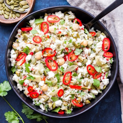 This Andalucían Cauliflower Rice Salad Bowl is a low carb, grain-free version of the traditional Spanish rice salad. Full of healthy fats, salty, briny flavors and no cooking required! #lowcarb #cauliflowerrice #salad #grainfree
