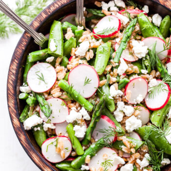 Asparagus Farro Feta Salad is a light and healthy salad to serve this spring! Full of spring's finest produce and tossed together with a tangy lemon vinaigrette. It's perfect as a side dish or add chicken or chickpeas and turn it into a main dish salad! #salad #asparagus #farro #springrecipe #vegetarian