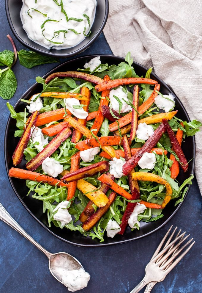 Five-Spice Roasted Carrot Salad with Mint Tahini Yogurt Sauce is full of warm, sweet, earthy flavors. Who knew these simple ingredients could taste so amazing together! #carrots #salad #glutenfree