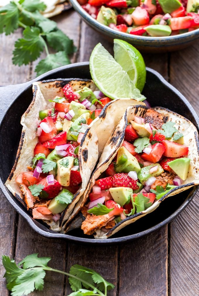 Grilled Salmon Tacos with Strawberry Avocado Salsa will be a hit this grilling season! Mexican spiced grilled salmon topped with the most flavorful sweet, savory and spicy salsa. Tacos you can feel good about eating! #tacos #salmon #strawberries #avocado #salsa #grilling #glutenfree