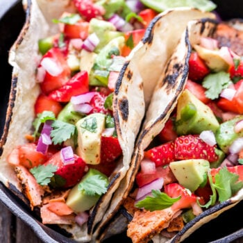 Grilled Salmon Tacos with Strawberry Avocado Salsa in small cast iron skillet