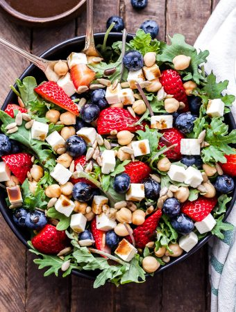 Berry, Chickpea, Feta Salad with Honey Balsamic Vinaigrette is perfect for spring and summer! Bursting with fresh berries, salty feta, chickpeas, crunchy sunflower seeds and a fabulous honey balsamic vinaigrette. An easy, delicious and beautiful salad that's sure to become a new favorite! #salad #strawberries #blueberries #feta #chickpeas #vegetarian