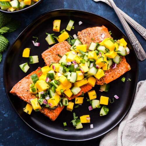 Grilled Salmon with Mango Cucumber Mint Salsa is a must make this grilling season! A fast, fresh, healthy and flavorful dinner you'll be making all summer long.#salmon #grilling #mango #salsa #paleo #glutenfree