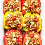 Mediterranean Stuffed Peppers are a vegetarian dish that's full of fragrant spices and fresh flavor. You'll love this updated version of stuffed peppers and won't miss the meat at all! #stuffedpeppers #vegetarian #mediterranean #dinner #glutenfree