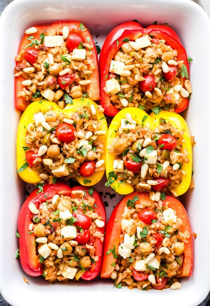 Mediterranean Stuffed Peppers in white casserole dish