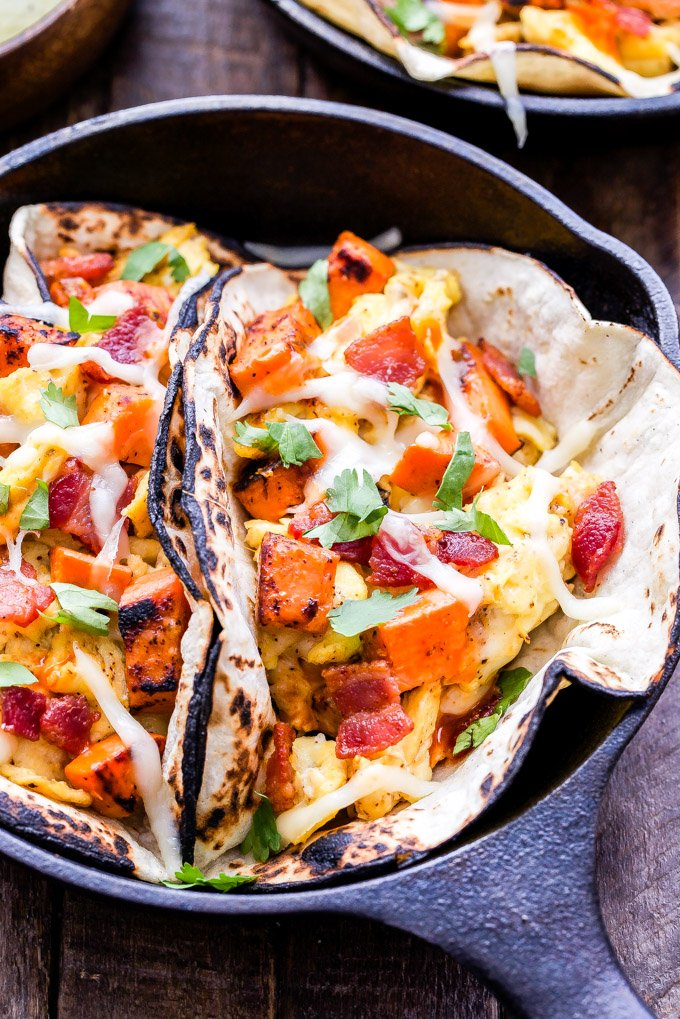 Sweet Potato, Bacon and Egg Breakfast Tacos are a dream come true for taco lovers! A super satisfying and delicious breakfast! #breakfasttacos #bacon #sweetpotato #egg #tacos #breakfast