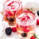 Berry Rosé Sangria is the perfect summer sipper! Sweet, but not too sweet and loaded with fresh berries, it will be a hit at all your summer parties! #sangria #rosé #strawberries #raspberries #blackberries #summercocktail #drink #wine