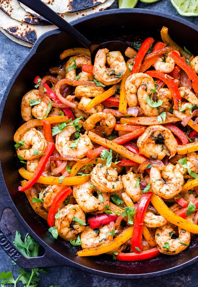 Skillet Shrimp Fajitas couldn't be easier to make and they'll be on your table in 30 minutes or less! Paleo, gluten-free and a great alternative to chicken or beef! #shrimp #fajitas #paleo #glutenfree #healthydinner