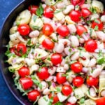 This White Bean, Artichoke and Tomato Salad is a light and healthy salad that's perfect for summer! Dressed in a simple lemon vinaigrette and full of fresh herbs, it's a great side dish to go with your favorite grilled protein! #salad #vegan #beans #tomatoes #lemon #sidedish #glutenfree