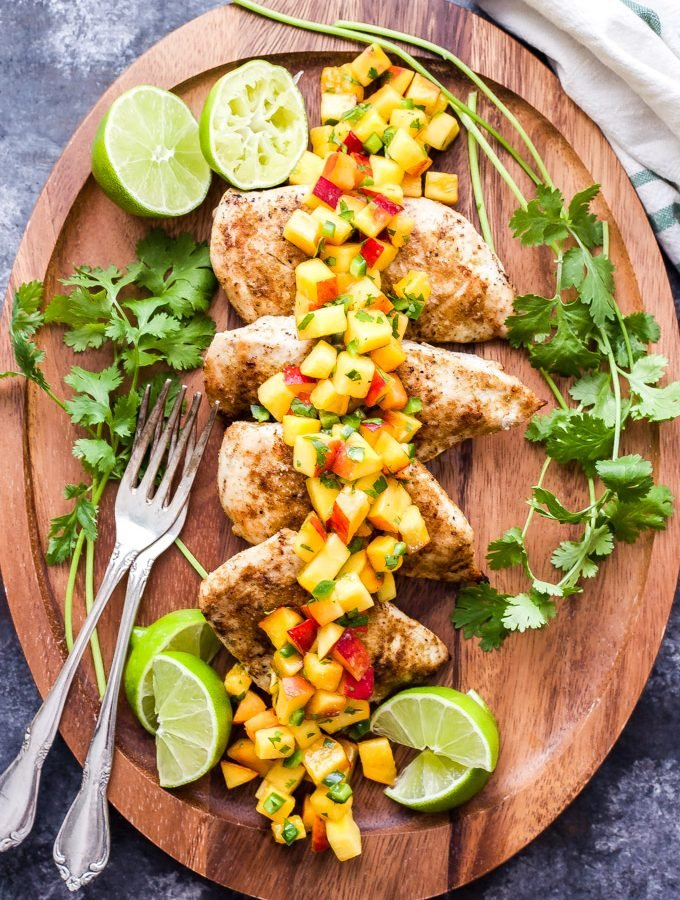Grilled Cumin Chicken with Peach Salsa is a quick and easy dinner that's perfect for those hot summer nights! On the table in 30 minutes or less, it won't disappoint! #chicken #grilledchicken #easyrecipe #glutenfree #peaches #salsa #dinner
