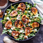 Grilled Fig, Goat Cheese and Pistachio Salad is a delicious and seasonal salad to make this summer! Sweet and slightly smoky grilled figs, tangy goat cheese, pistachios and a maple balsamic vinaigrette all top this flavorful salad. #figs #salad #goatcheese #pistachio