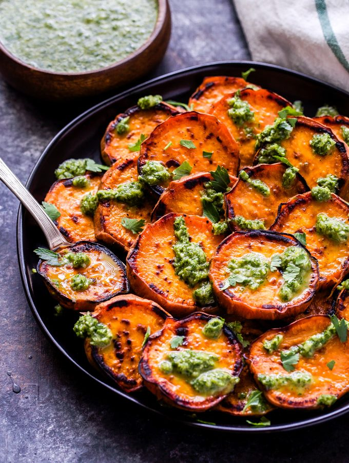 Grilled Sweet Potatoes with Cilantro Chimichurri are the perfect side dish to make this summer! The mild sweetness and char of the potatoes combined with the fresh, bright flavors of the chimichurri is the ultimate combination! #sweetpotatoes #chimichurri #cilantro #sidedish #glutenfree #paleo #vegan