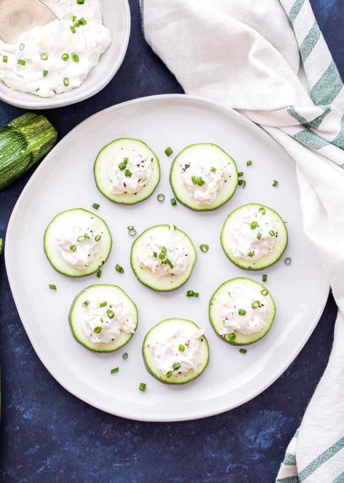 Artichoke Dip Zucchini Bites are a quick and easy appetizer to serve at your next party. A lightened up and lower carb alternative to the traditional dip, but with the same familiar flavor! #zucchini #artichokedip #appetizer #glutenfree #lowcarb #healthyrecipe