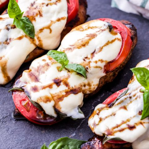 Caprese Balsamic Grilled Chicken is an easy and healthy dinner that's perfect for those sweet summer tomatoes! Balsamic marinated chicken breasts, thick slices of tomatoes, basil and fresh mozzarella.
