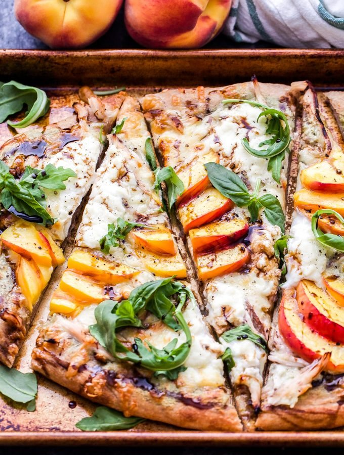 Chicken Peach Ricotta Pizza with Arugula and Balsamic Glaze is bursting with summer flavor! The perfect combination of savory and sweet that's not only great for dinner, but a tasty appetizer as well! #pizza #ricotta #chicken #peaches #dinner #appetizer