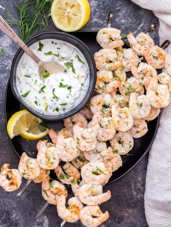 Lemon Dill Grilled Shrimp with Yogurt Herb Sauce are a healthy, fast and flavorful weeknight dinner or party appetizer! On the table in 30 minutes or less and gone in less time than that! #shrimp #grilling #easydinner #appetizer #seafood #glutenfree