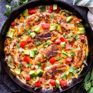 Enchilada Chicken with Black Beans and Corn in a black cast iron skillet