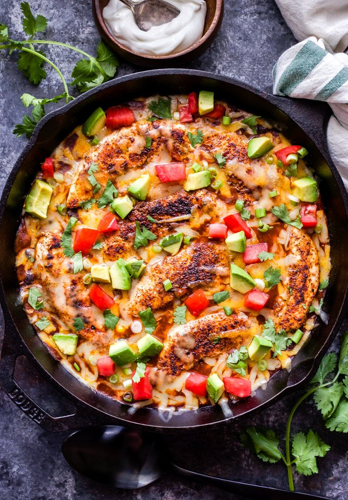 Skillet Enchilada Chicken with Black Beans and Corn is a quick and easy Mexican dinner that will be on your table in 30 minutes! All the flavor of traditional chicken enchiladas without all the work! #enchiladas #chicken #skillet #easyrecipe #glutenfree #easydinner