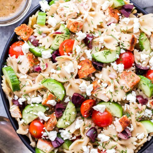 Greek Chicken Pasta Salad tossed in a red wine vinaigrette and loaded with cucumbers, tomatoes, kalamata olives and feta cheese!
