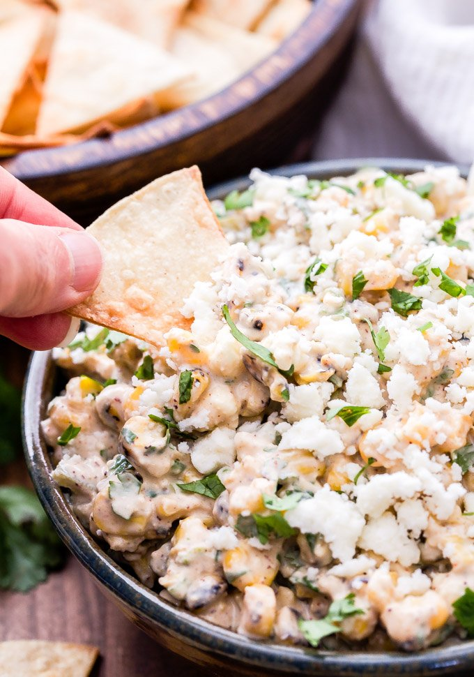 This Mexican Corn and Green Chile Dip will be a hit at your next party! Highly addictive and ready in 15 minutes or less! #dip #corn #greenchiles #Mexicanfood #appetizer #easyrecipe #glutenfree