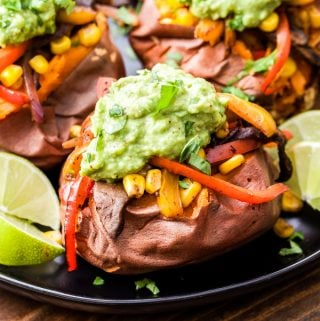 Baked sweet potatoes are topped with mushrooms, peppers and onions in a flavorful blend of Mexican spices. Topped with guacamole.