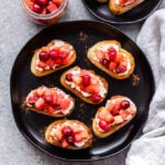 Goat Cheese Crostini with Cranberry Apple Compote is a sweet and savory bite that's perfect for Thanksgiving and the holiday season! It's easy to make and can be served as an appetizer or dessert. #crostini #cranberries #apples #goatcheese #appetizer #easyrecipe #thanksgiving #christmas