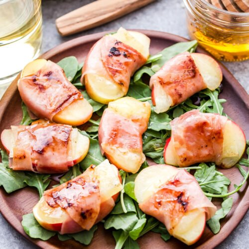 Prosciutto Wrapped Apples with Manchego Cheese are perfect for fall and holiday entertaining. Made with only four ingredients and can be ready to eat in 15 minutes or less! #appetizer #apples #prosciutto #cheese #glutenfree #thanksgiving #fall #easyappetizer
