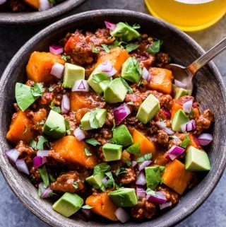 This Slow Cooker Bison Sweet Potato Chili is a hearty and healthy meal that's perfect for serving on a cold day. Sweet potatoes replace the beans in this recipe and make it a great option if you're following the Paleo or Whole30 way of eating. #chili #slowcooker #sweetpotato #bison #glutenfree #paleo #whole30