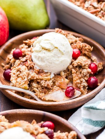 This Apple Pear Cranberry Crisp is a must make this holiday season! Gluten-free and perfectly sweetened, you won't be able to resist going back for a second helping! #applecrisp #pears #cranberries #glutenfree #dessert #thanksgiving #christmas