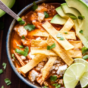 This Slow Cooker Chicken Tortilla Soup couldn't be easier to make! Loaded with chicken, black beans and all the toppings you could possibly want. It's the perfect dinner for a cold night! #soup #chickentortillasoup #chickenrecipe #glutenfree #slowcooker #easydinner