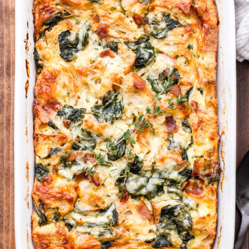 This Spinach, Bacon and Cheese Strata will be a fantastic addition to your next holiday brunch or weekend breakfast! Make it the night before and bake it in the morning for a stress free, hearty egg dish everyone will enjoy! #strata #eggs #bacon #spinach #bread #brunch #breakfast #christmas #thanksgiving #breakfastcasserole