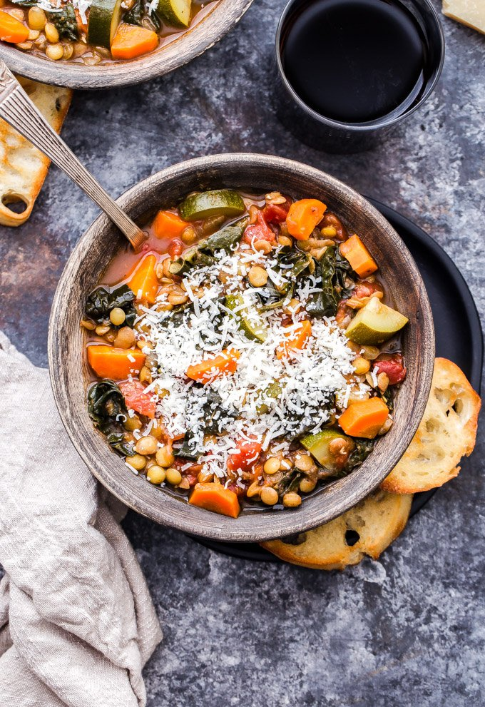This Italian Lentil and Vegetable Soup tastes similar to a minestrone soup, but with the addition of hearty and protein rich lentils. It's a thick, flavorful, healthy, vegetarian soup that's completely satisfying! #soup #lentils #vegetables #Italiansoup #glutenfree #vegetarian #vegan #healthyrecipe
