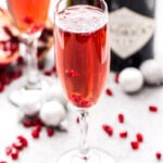 The Pomegranate French 75 is the perfect drink to add to toast with this holiday season and a must for brunch! Bubbly, sweet and floral with a touch of tart flavor from the pomegranate. Cheers! #cocktail #French75 #gin #drink #pomegranate #christmas #newyearseve #valentinesday #champagne