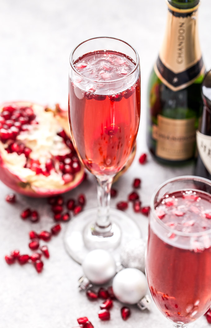 The Pomegranate French 75 is the perfect drink to add to toast with this holiday season and a must for brunch! Bubbly, sweet and floral with a touch of tart flavor from the pomegranate. Cheers! #cocktail #French75 #gin #drink #pomegranate #christmas #newyearseve #valentinesday