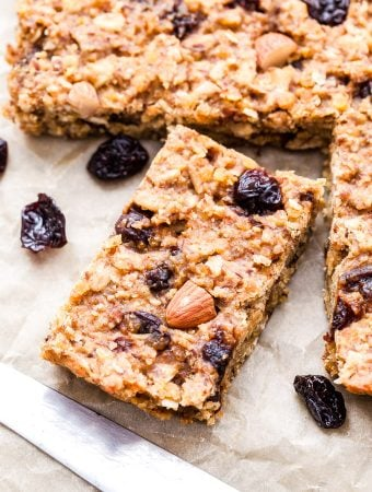 Cherry Almond Red Lentil Granola Bars are perfect for refueling with post-workout or for a healthy and delicious snack! These soft and chewy bars are packed with nutrients thanks to red lentils, and I promise, you won't even know they're in there! #lentils #granolabars #veganrecipe #glutenfree #healthysnack #energybar #cherry #almond
